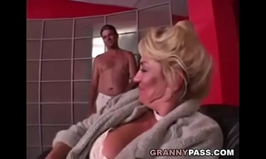 Busty grandma is getting her twat stuffed