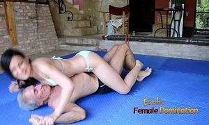 Turquoise bikini housewife wrestles old fellow