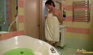 Sexy lesbo dominates sweetheart in bathtub vibrator fucking