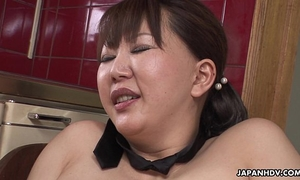 Chubby japanese milf groans during the time that her curly twat is toyed