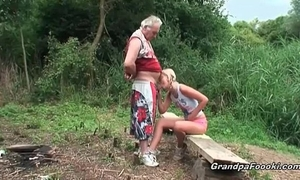 Blonde sweetheart gives head in the nature