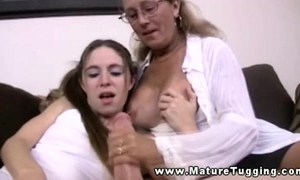 Mature milf in threesome tugging rod for this favourable fellow