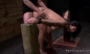 Dark haired oriental honey shackled and drilled