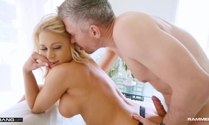Lusty blonde MILF in fishnet stockings takes care of Mick's dick
