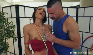 Sporty brunette with fake boobs gets deeply fucked