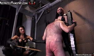 Two femdom mistresses cane male serf to his knees