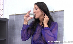Toying her anal opening in paddling pool full of her own piddle